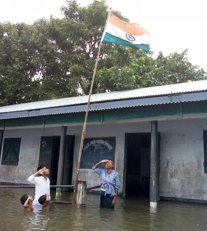 Teachers and Young Schoolgoers Saluting the Indian National Flag on India Independence Day | Picture Credit : Mizanur Rahman, Facebook